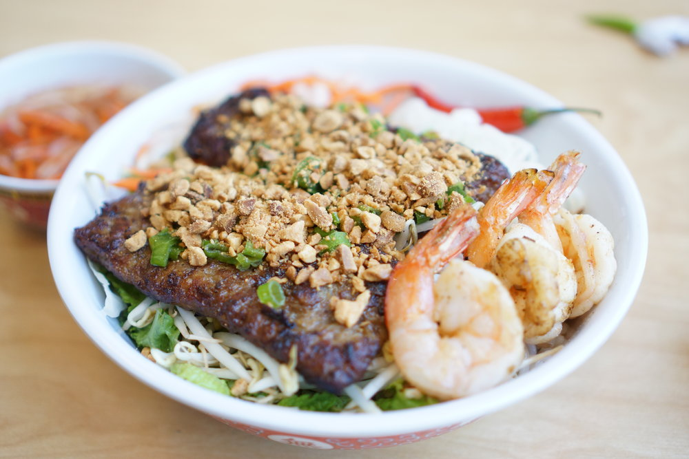 Bún Tôm Thịt Nướng - Delicious and refreshing dish of BBQ pork and shrimp over vermicelli noodle and blend of lettuce, bean sprouts, pickle carrots and daikon