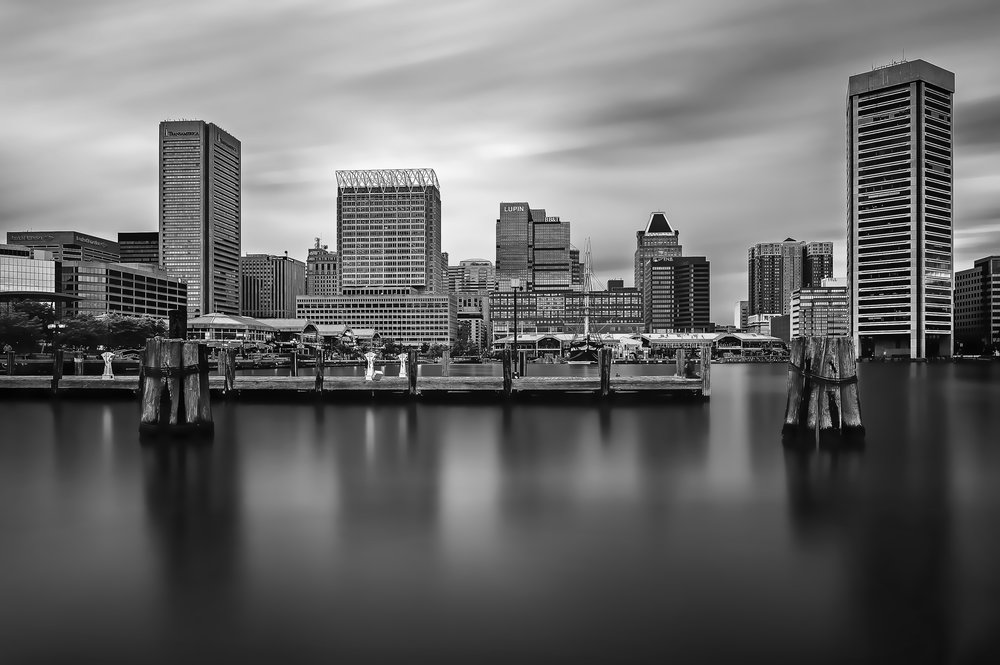 The Inner Harbor at Baltimore shot at dusk in early June. This image is a composite of 82 separate images shot on a tripod, each image taken approximately two to three seconds apart. In post-processing, the images are stacked in Photoshop and then merged, allowing the motion from each image to give the effect of a long exposure. Long exposures are a great way to create that dreamy effect, but when you don't have the proper neutral density filters on you, or the light is just too intense to get a three-or four-minute exposure, this stacking method is great.