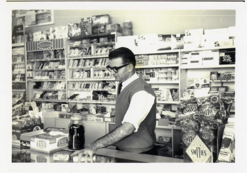 Eleftherios Stefanou at work in his Snack Bar. He migrated to Australia in 1951 and moved with his wife to Adelaide in 1961.  PN06156 Migration Museum Collection