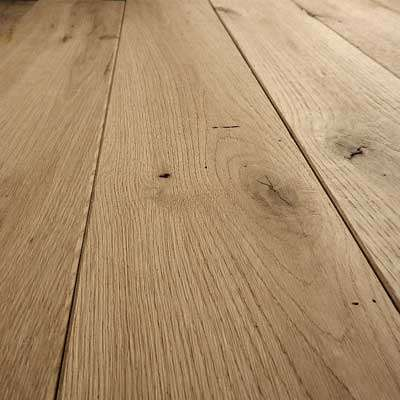 Reclaimed French Oak Flooring Re milled Dressed Face   The traditional oak flooring features knots, some nail holes, and occasional surface checking. This character, along with inherent strength and water-resistant qualities, has made reclaimed oak a floor of choice.