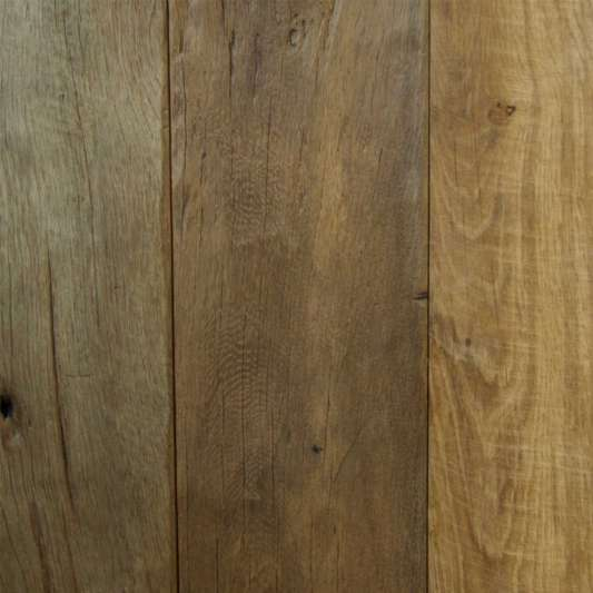 Reclaimed French Oak Flooring Re milled Original Face   This traditional oak flooring features knots, some nail holes, and occasional surface checking. This character, along with inherent strength and water-resistant qualities, has made reclaimed oak a floor of choice.