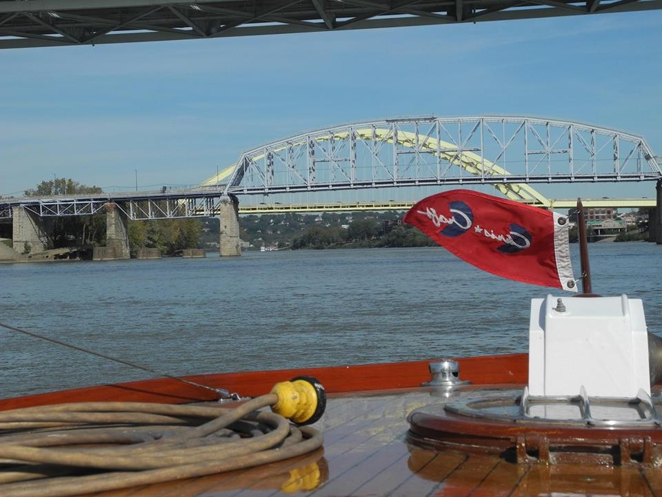 Sailing upstream on the Ohio River off Cincinnati. Purple People Bridge (fore). Daniel Carter Beard (back)