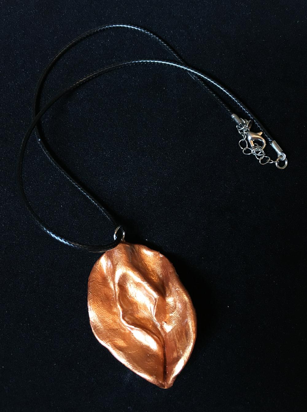 copper-vulva-necklace.png