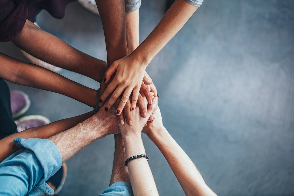 bigstock-Stack-Of-Hands-Showing-Unity-A-153849635.jpg