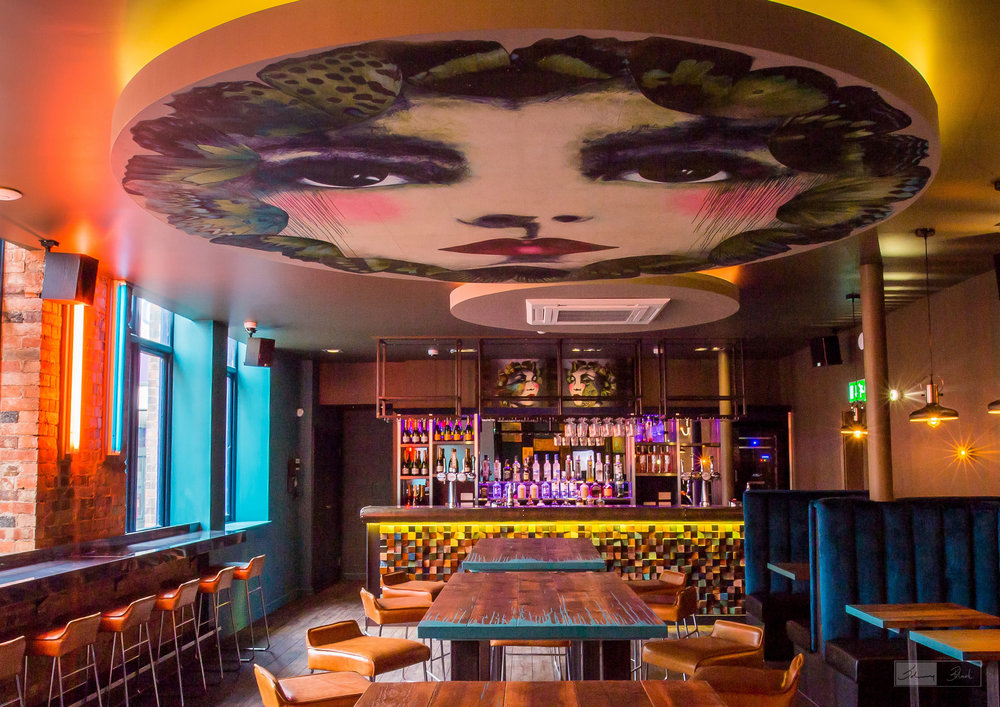 'Ettie' and 'Reflection of Biba' - The Study aka Blind Tiger - Large ceiling collage on bespoke disc with colour changing lighting using acrylic and spray paint.Double portrait piece hangs above bar.Photo credit: Johnny Black