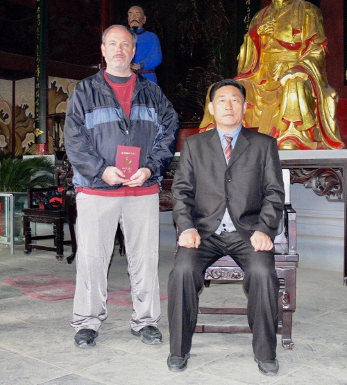 James Cravens with GM Chen Xiaowang (2006 China)