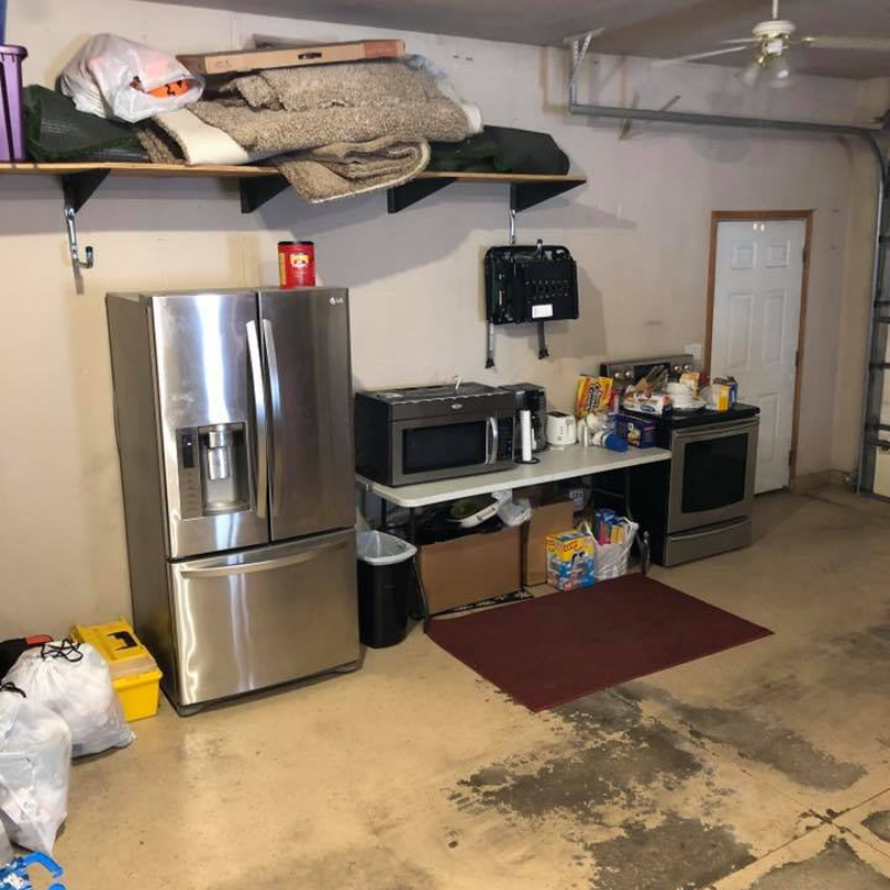 Find a spot for your temporary kitchen - in a different room of the house or in your garage.