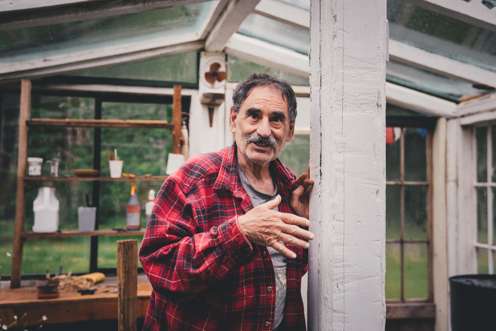Jimmy in his self-fabricated greenhouse.