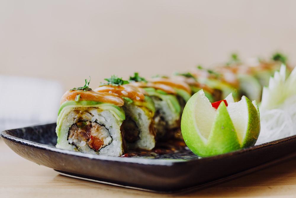 Spicy Sumo - spicy crab mix, avocado, jalapeno, salmon, spicy mayo, ponzu, togarashi, cilantro
