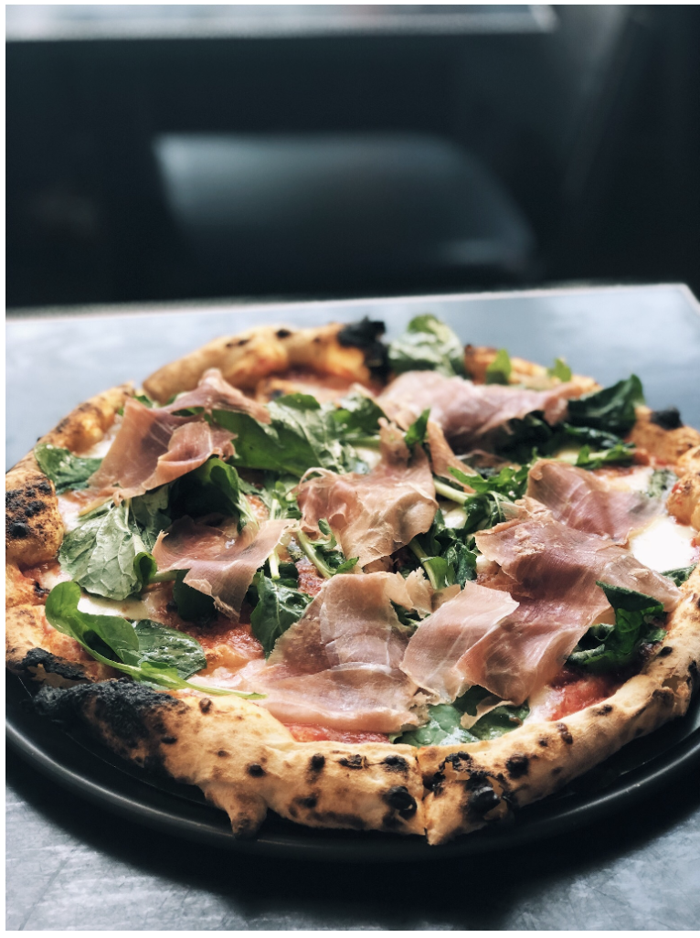 One of her favorites: The Margarita Pizza with added Arugula and Prosciutto