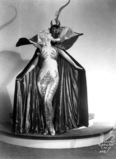Actress Marian Martin in a Satan-themed burlesque cape
