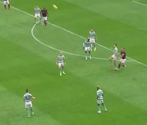 Instead of passing it to an open outlet, he boots the ball up the pitch where Celtic promptly loses possession again.
