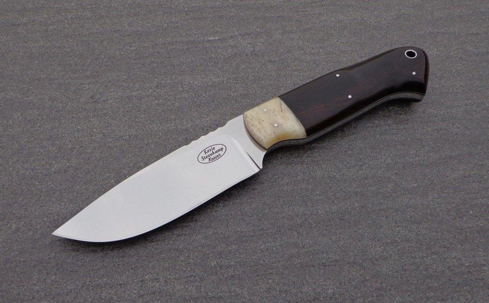 Blade: Böhler N690 Stainless Steel. Coachwork: Giraffe Bone. Handle slabs: African Hardwood.