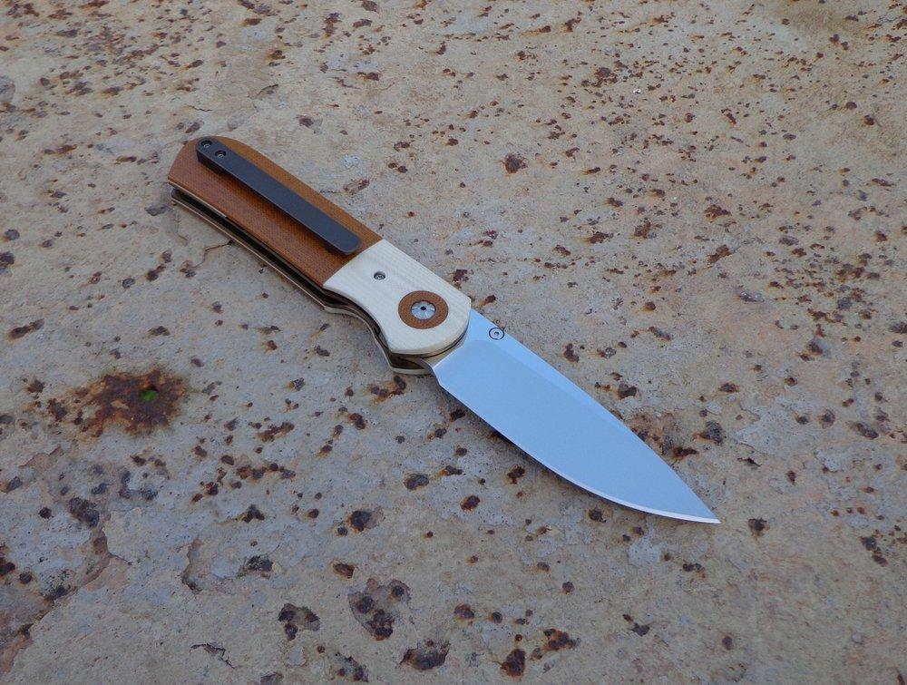 Knife: Samson Liner Lock. Böhler N690 Stainless Steel Blade. Titanium liners. Canvas Micarta and G10 handle. Titanium belt clip.