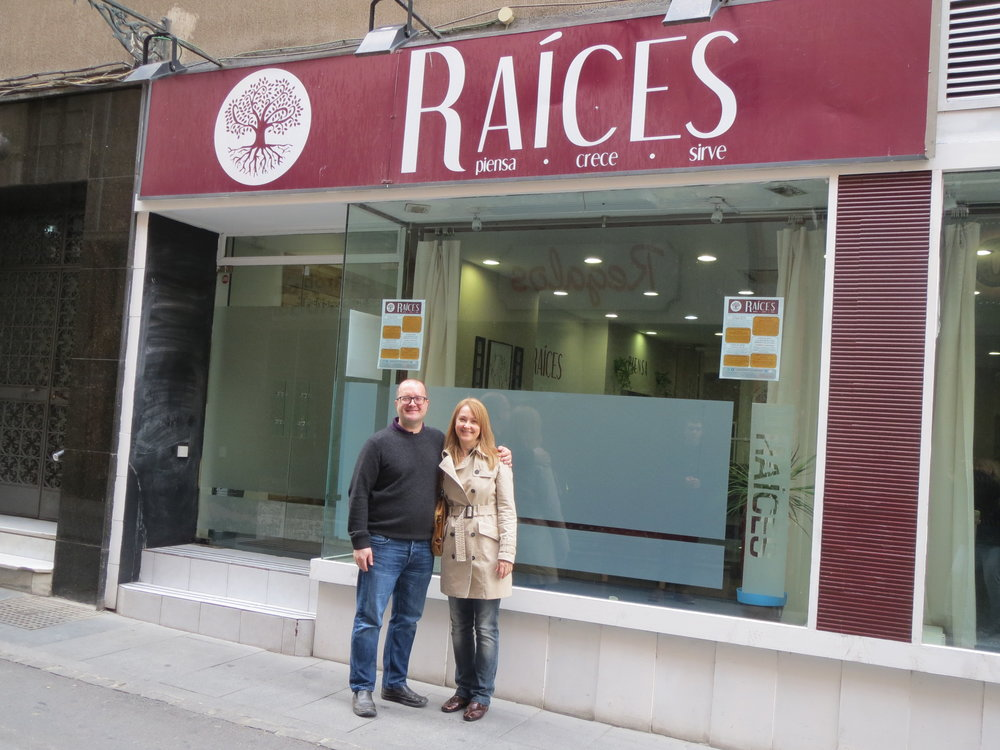 Raices street sign with Shawn and Deb.JPG