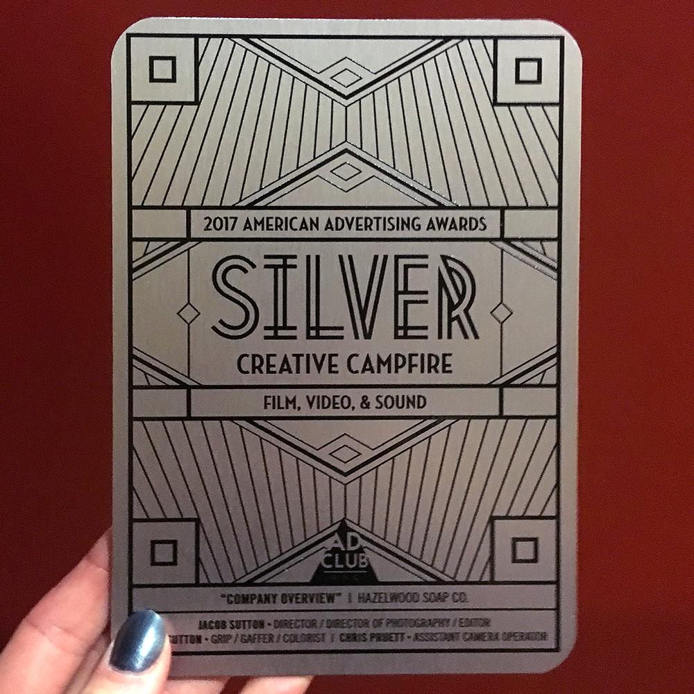 Silver award printed on brushed metal