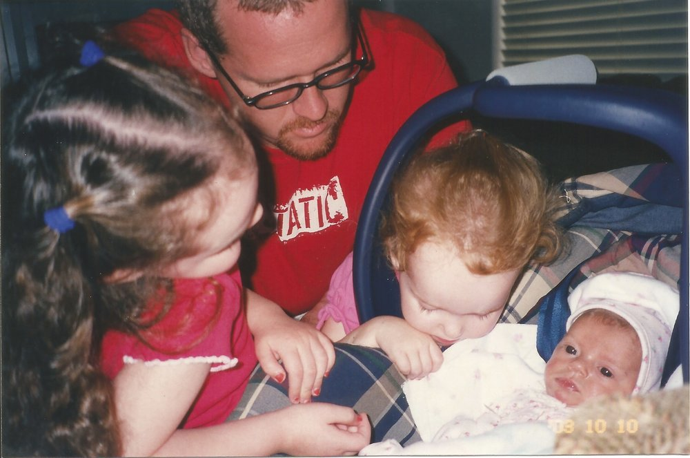 Sisters, Kylie and Christian welcome Kenedee home from the hospital.