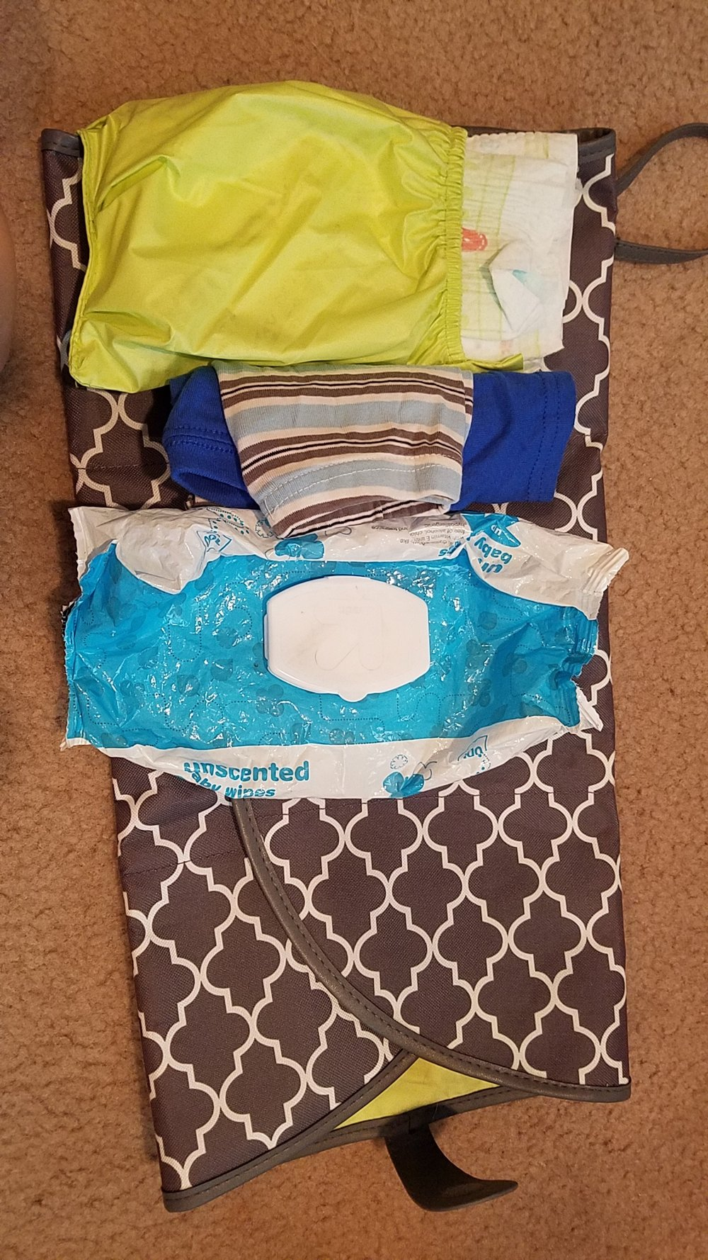 This a diaper changing mat that I am able to fit one complete set of extra clothes, two diapers, and a pack of wipes.