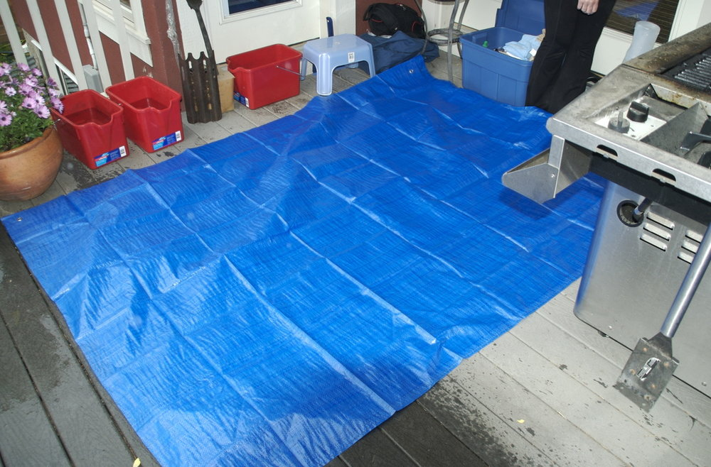 We Protect Your Deck and Patio - We use two tarps folded in half, one over the other, giving four layers of protection between us and your deck.