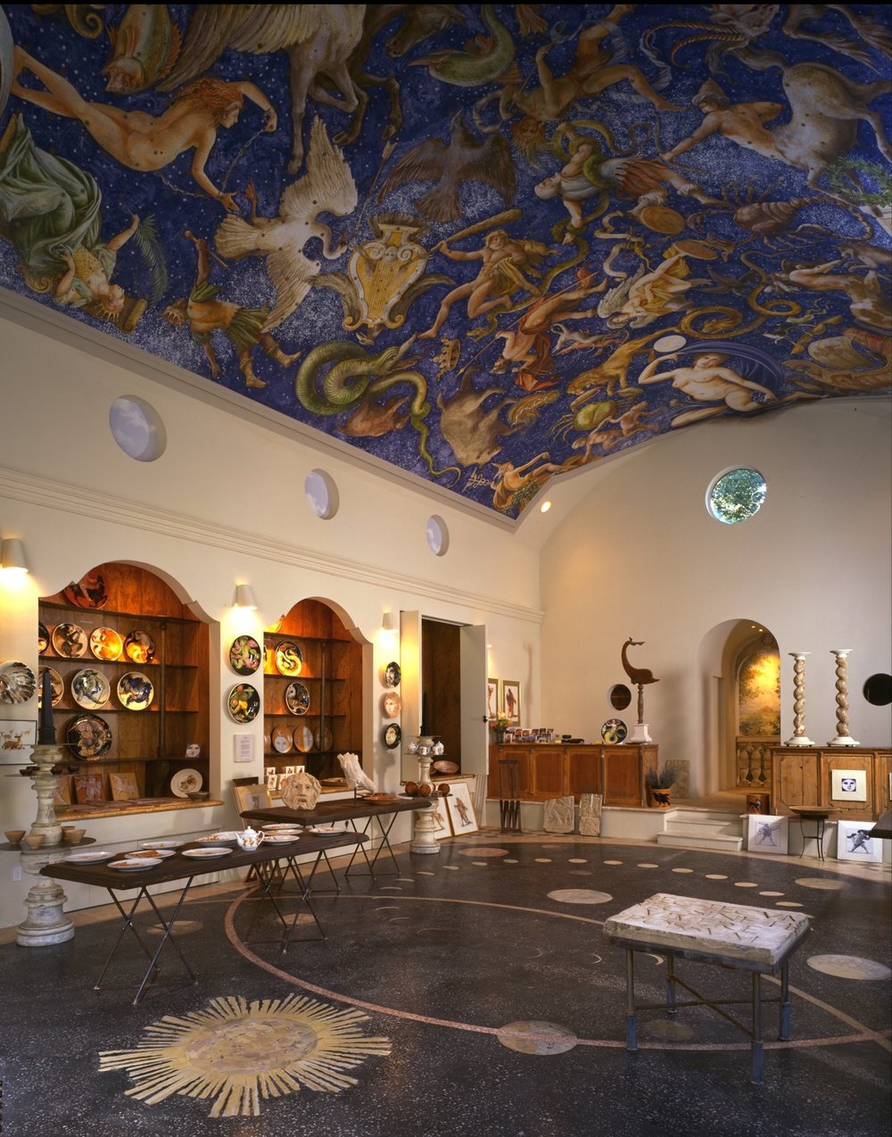 The interior of Ca' Toga Art Gallery displaying a 44 x 23 foot mural painted on the barrel-vault ceiling.