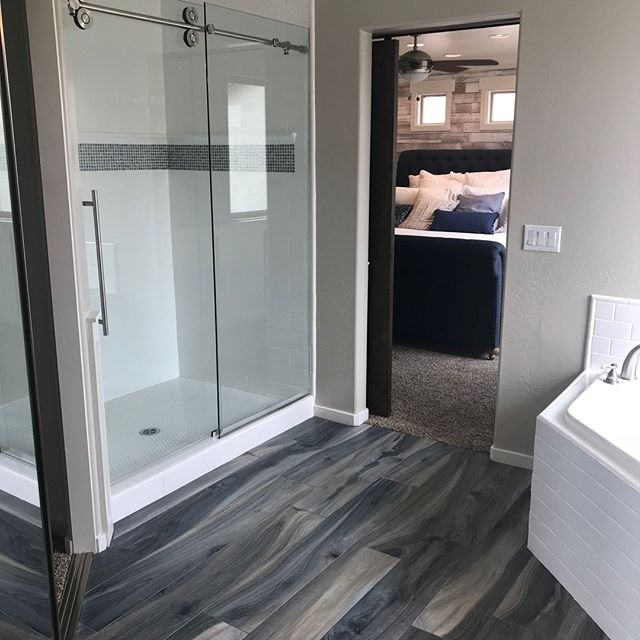 Walk-in shower, wood tile floors
