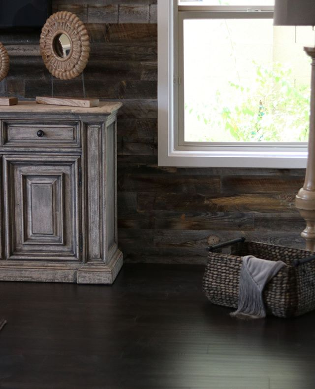Dark wood floors, barnwood walls