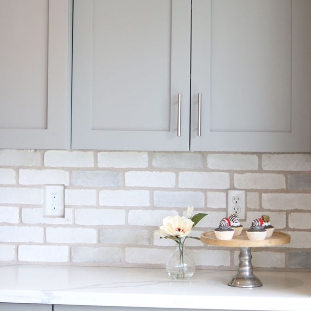 Brick and gray cabinets