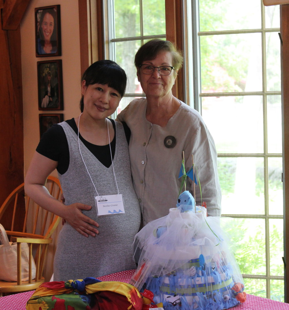 "Sally Rianhard created a ""diaper cake"" for expectant Noriko Crasso."