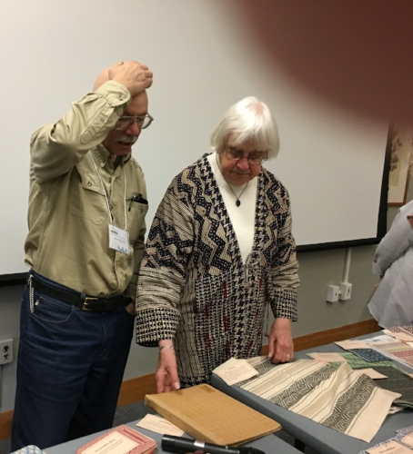 Norma Smayda and Dave Westcott discussing BGH weavings.