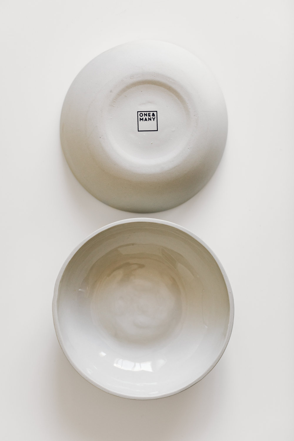 One & Many - Yaara Landau-Katz makes this beautiful line of ceramics out of her studio in Israel - definitely not local for me, but these were a special buy to have a few bowls from another part of the world!She has an industrial design background, a love for clean, modern lines, and a minimal color pallet.Pictured here are her 'ceramic plates', although I would categorize them as bowls, great for soups, desserts, and snacks.Visit her site here. (She is also on Etsy.)