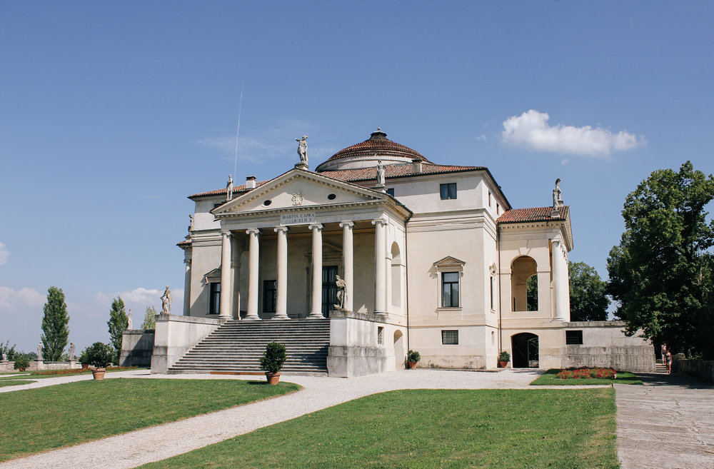 Villa La Rotonda designed by Andrea Palladio in the mid-16th Century.  The Renaissance Villa is completely symmetrical building having a square plan with four facades, each of which has a projecting portico. The whole is contained within an imaginary circle which touches each corner of the building and centres of the porticos.