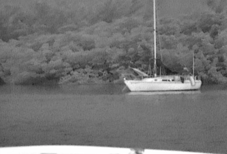 A Yacht, moored in total darkness, but with the Night Tracker, clearly visible.