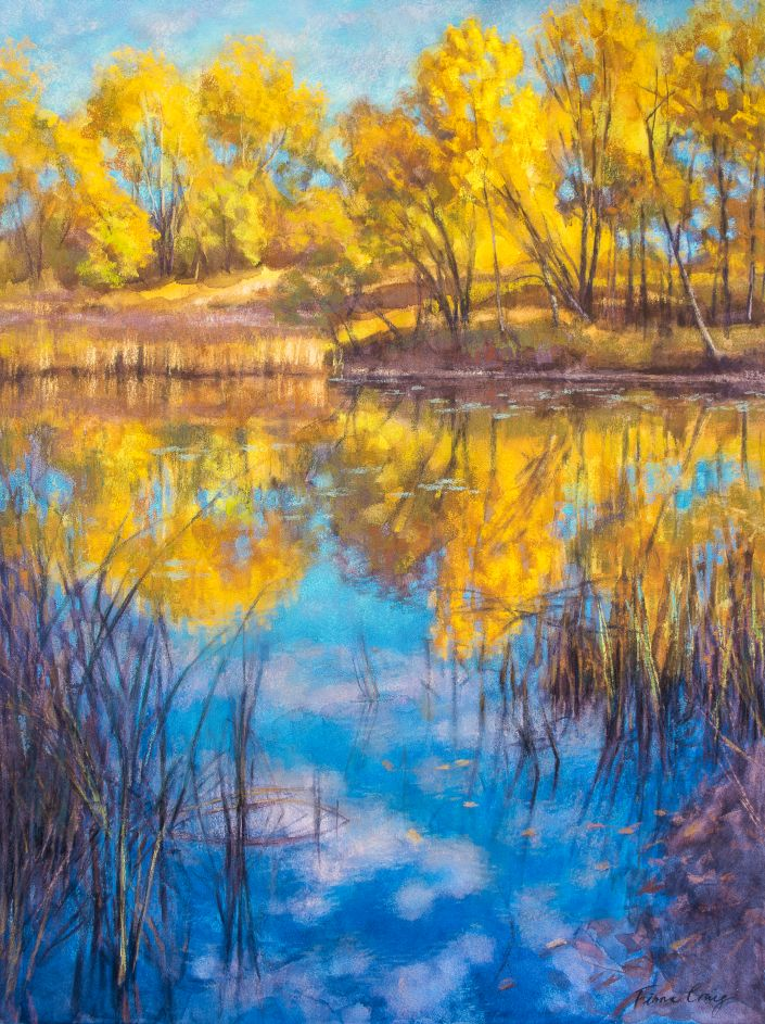 "Autumn on Wetlands - Mixed media (watercolour and soft pastel) on museum-quality wood panel, 18"" x 24"" x 1/8"". This painting was inspired by a late afternoon scene of brilliant autumn trees reflected in a wetland lagoon. The spiky reeds make abstract patterns as they enclose a winding visual pathway through the water, contrasting dramatically with the softly-rounded shapes of the foliage and clouds."