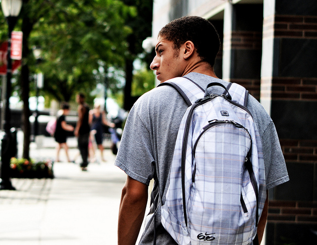 Adolescent w backpack Grit.jpg