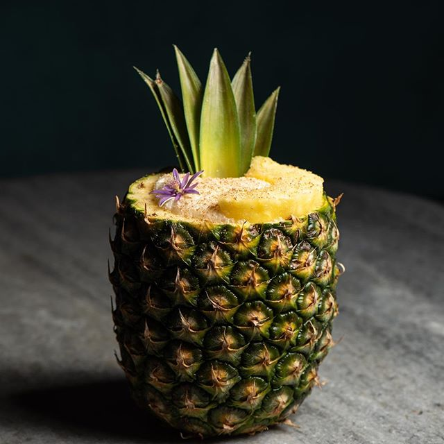 Isn't she a beauty! @wonhophoto Stuff dreams are made of! 🦄 National Rum day is next Thursday and we'll be hosting a Tiki Takeover PARTY but this Pineapple Painkiller is available right now! 🍍🍹#drinkrum #venicebeach #angelinocuisine #fridaymood