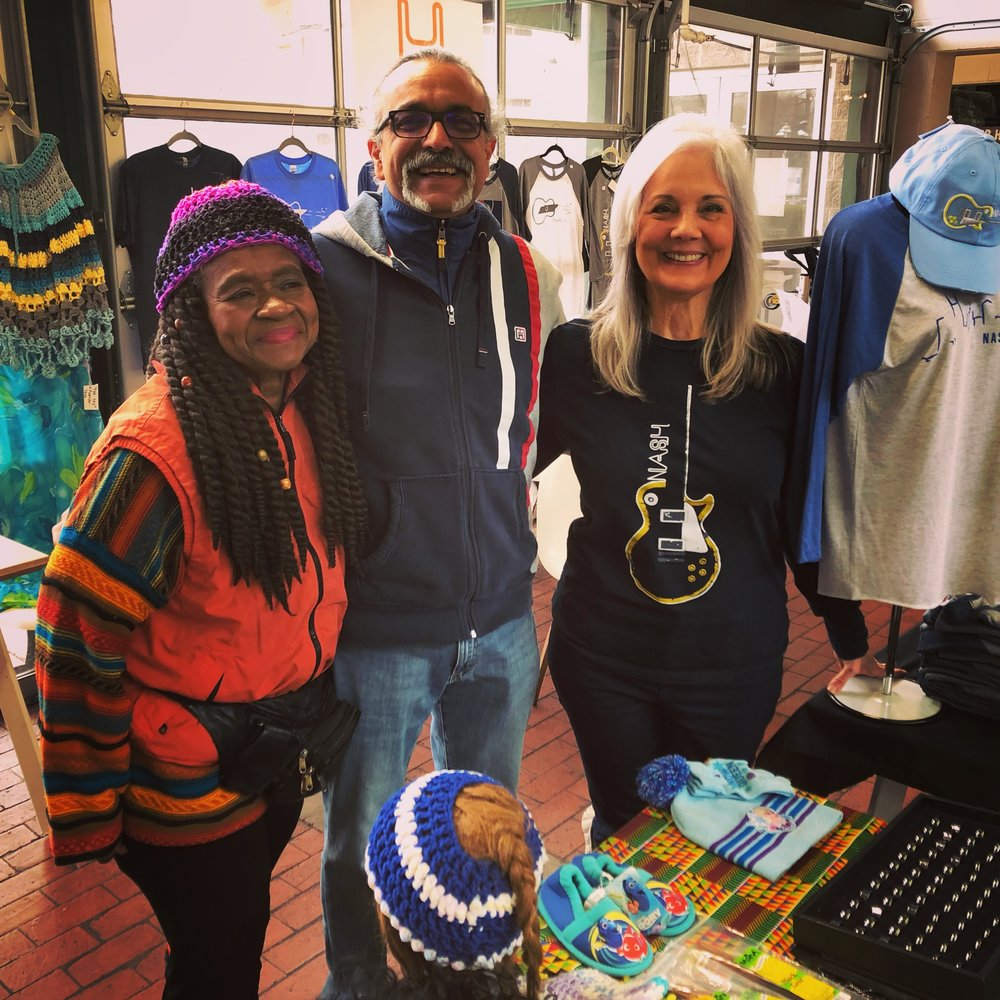 """""""What I love most about the market is the community of vendors that sell there as well as the staff that runs it,"""" says Helen Prater (at right), hanging out with fellow vendors Lily Webb and Ihsan Tunceren at a recent Wednesday Winter Market."""