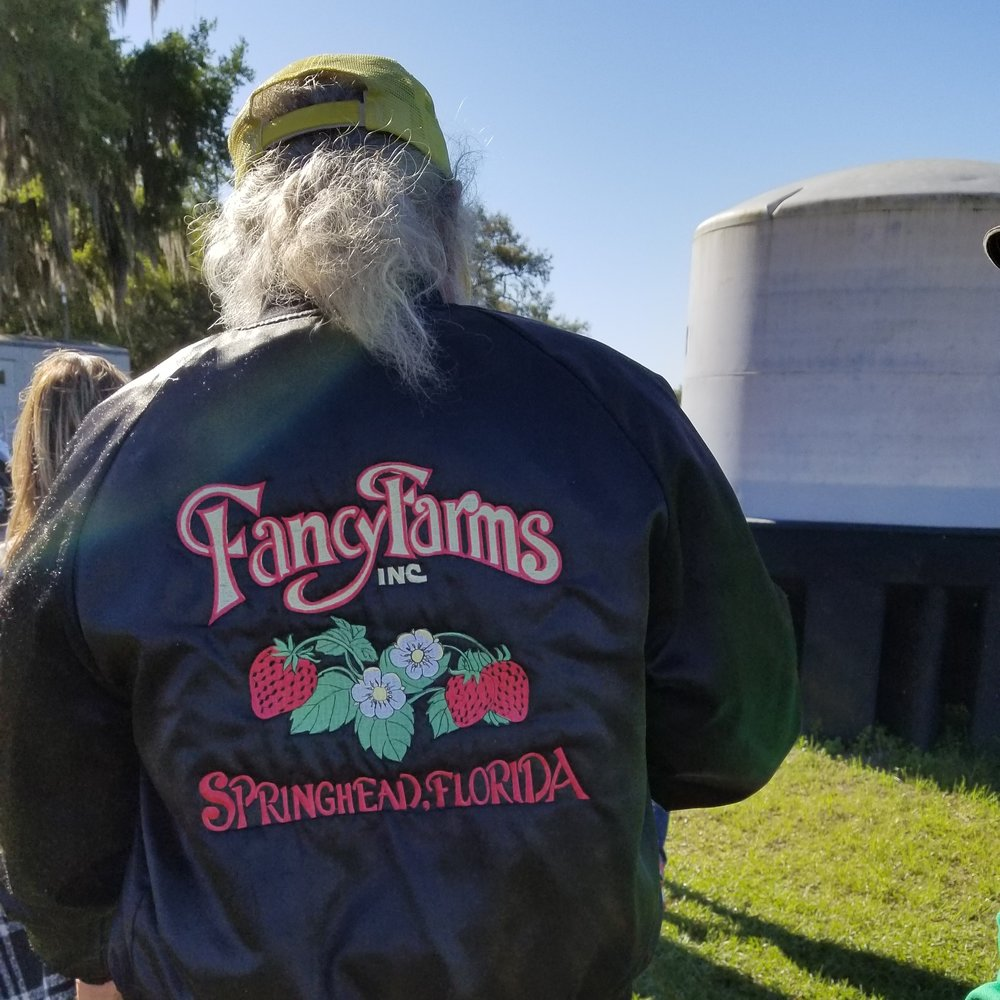 Fancy Farms in Plant City, Florida, is a family-owned operation run by Dustin Grooms and his father (in jacket), Carl Grooms.