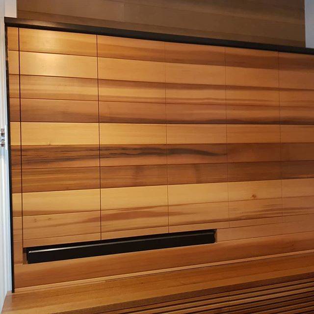 With these doors I'd be timber and chilling rather than netflips and chill! We used the @hafele_aus system to bifold and slide these doors to reveal the television and shelving.  The timber is Western Red Cedar. The lower cabinets will house speakers. When not in use this unit doubles as a seat!