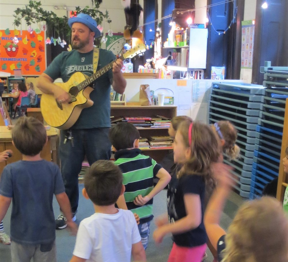 Joe Morris - Mr. Joe started making music at TPG in 2006. He is an accomplished singer and guitarist who rocks the house each week, exposing the children to musical diversity, instruments, rhythms, beats, tones, rhymes, chants, name games, and dance moves, not to mention party soundtracks.