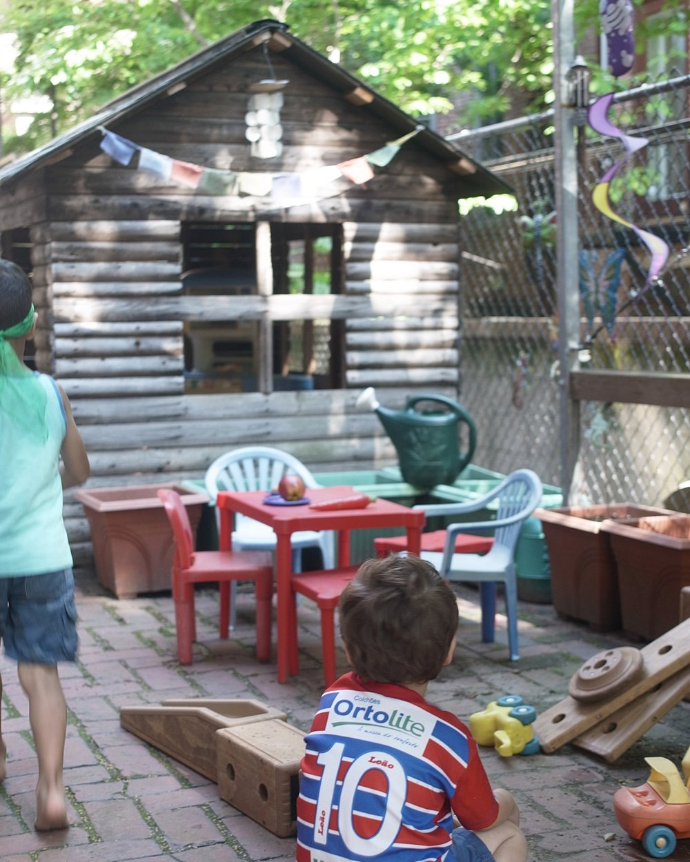 And we have our own side yard! - We spend a lot of time in the yard playing in the log cabin, digging in the sandboxes, ramping and rolling, and having fun with water play.