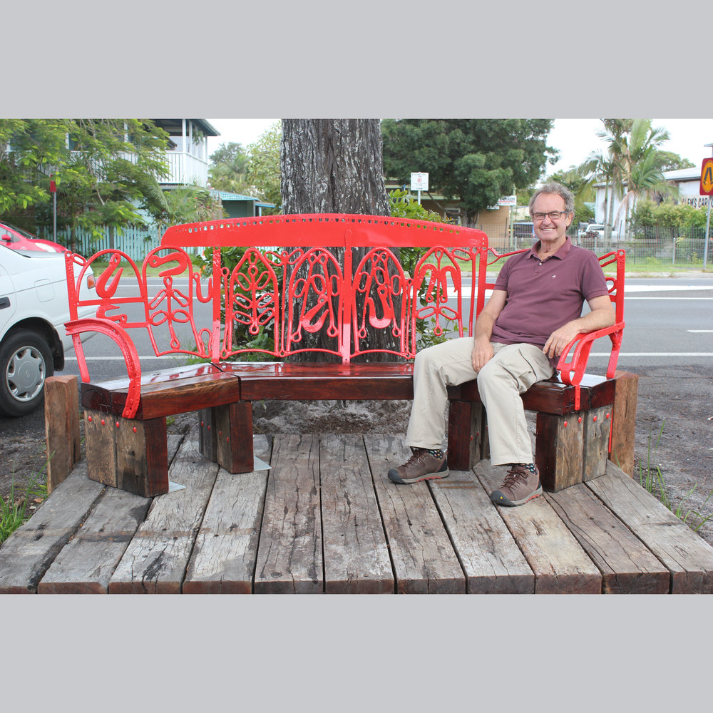 Frank Mills Historical Seat  I  2015   - Old steel and re-purposed railway sleepers.Brunswick Heads NSW. Commissioned by Brunswick Heads Chamber of Commerce.Frank Mills is a well known local historian and raconteur whose contribution to community was duly recognised in this piece. Frank is still living locally as he has done all his life. The steel for the seat was primarily produced from Frank's own collection of hardware from his bullock team harnesses and his timber cutting days.