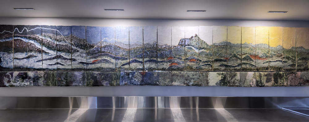 Undulating Land  I  2015 - 500W X 120H cm Ceramic 2015Commissioned by Elements of Byron Resort depicting local landscape, multiple flora species and naturally occurring textures