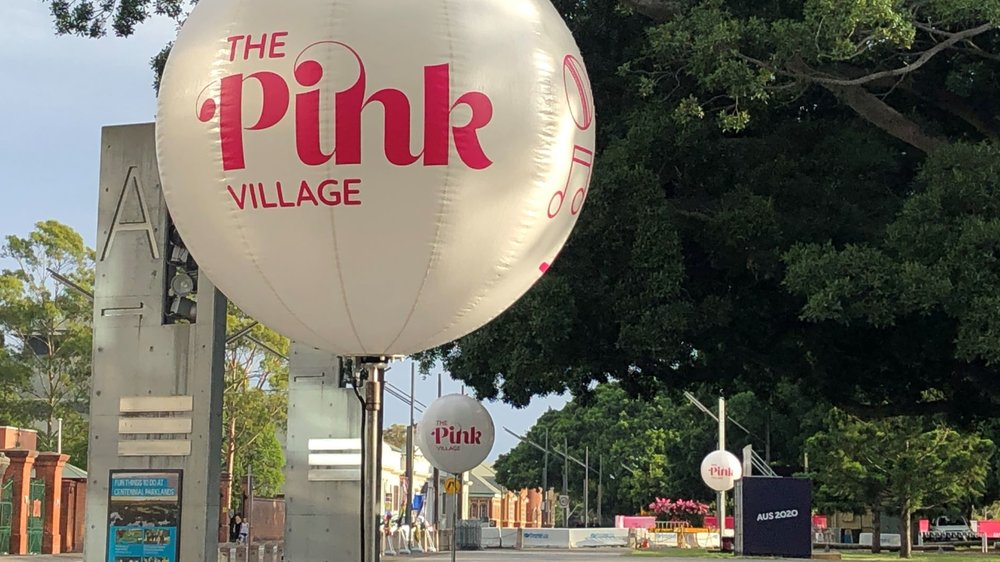 "Cricket Australia's Pink Test Jan 2019 : directing crowds to the ""Pink Village"" entertainment precinct. Really helps when construction and ""hostile vehicle management"" barriers and bollards make wayfinding tricky."