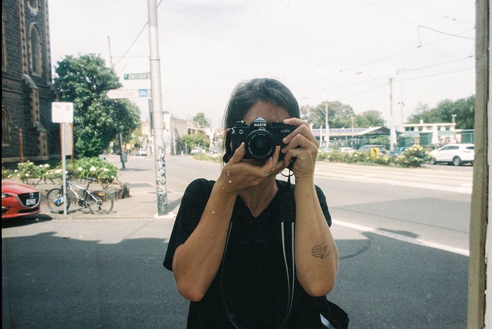 Maggie Given - Hi, I'm Maggie. I'm a meditative runner, a natural wine aficionado and an admirer of classical music. I also never leave the house without one of my cameras in my bag, and am rarely without an accompanying notebook.Creating art has always been an integral part of who I am and how I live, and I have found the camera to be an avenue through which I can tell stories, express and evoke emotions, and open up a visual dialogue. I rely on intuition when shooting photos, seeking to capture a moment naturally even if I am consciously composing elements within that particular shot. I mostly shoot with a 35mm film, using a Nikon Fm3a camera that was gifted to me by my grandmother. Having this connection with her through my camera is huge for me, and it no doubt influences my work in various ways.Increasingly, I feel my work becoming part of a larger narrative that has to do with the flow of time, the beauty of natural light and the contrasts which unfold with shadows and space, and a deep sense of nostalgia for the quieter, simpler moments in life.I find that these moments tend to occur in a space where the human and natural worlds intersect one another. Maybe this is why I constantly find myself chasing shadows around the city…Follow Maggie:Instagram: @magsgiven