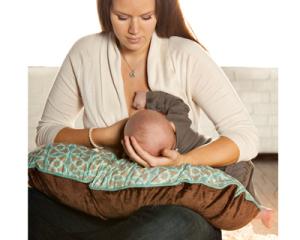 Uncomfortable mom trying breastfeeding positioning