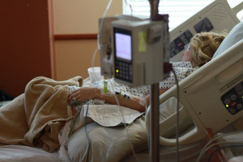 Woman in labor in a hospital bed
