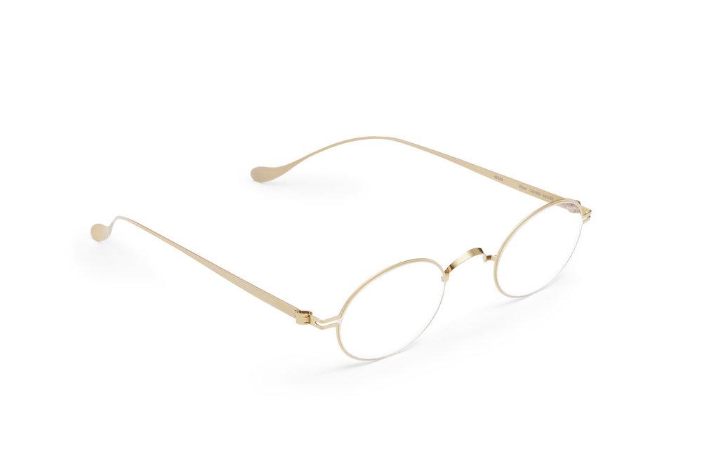 haffmans_neumeister_faun_gold_clear_line_eyeglasses_angle_102236.jpg