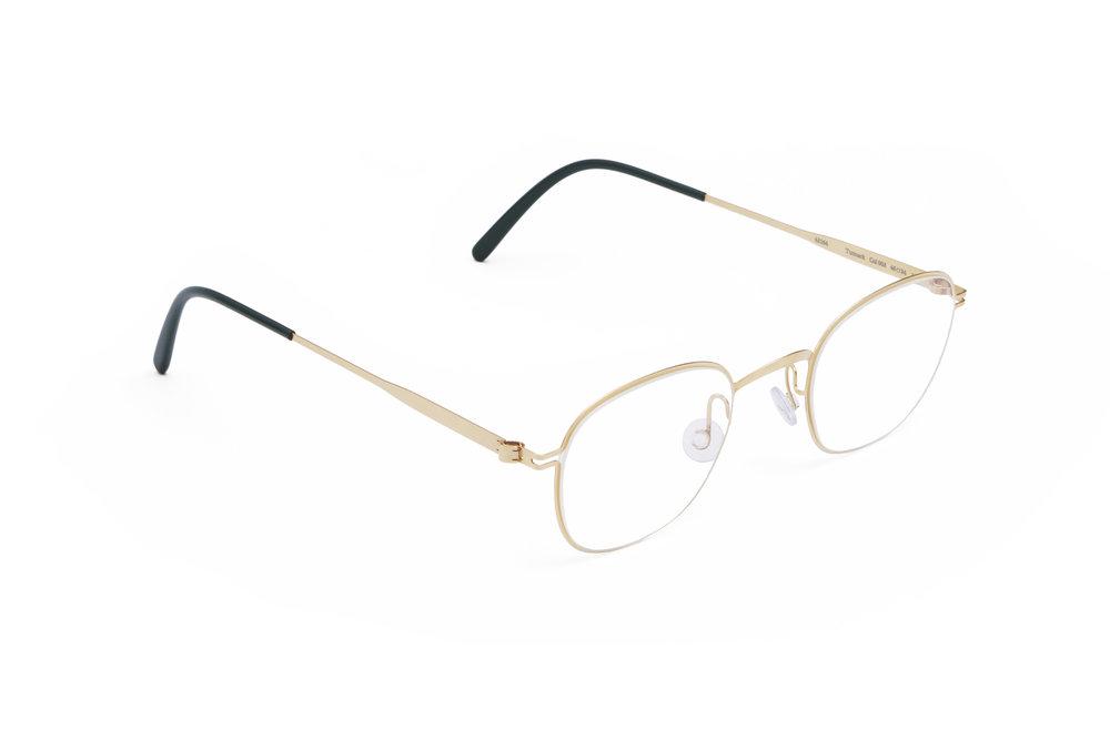 haffmans_neumeister_tutmark_gold_darkgreen_clear_line_eyeglasses_angle_102073.jpg