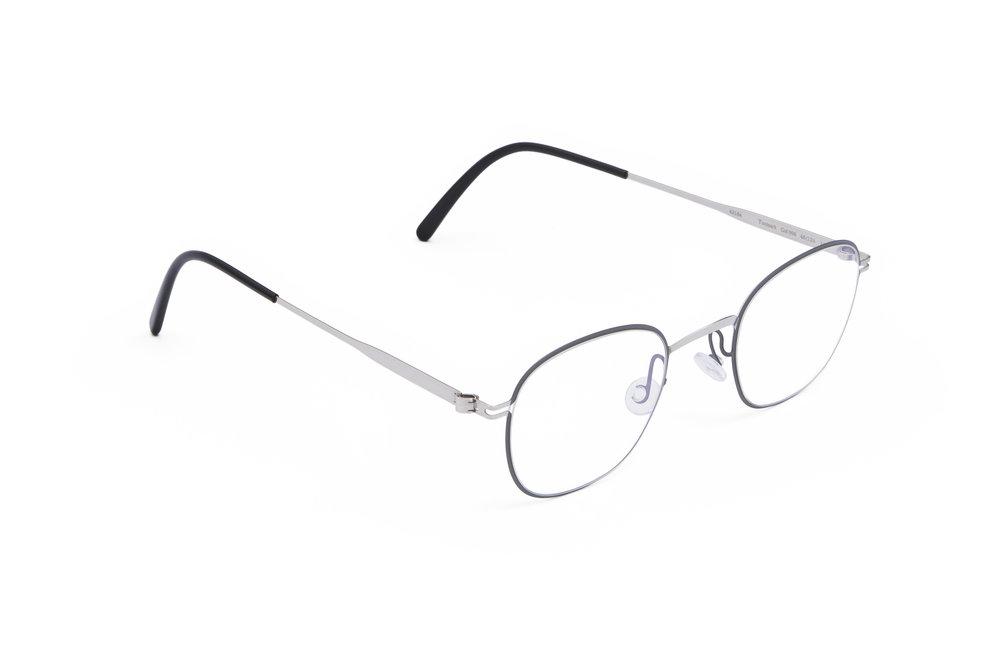 haffmans_neumeister_tutmark_silver_grey_black_clear_line_eyeglasses_angle_102076.jpg