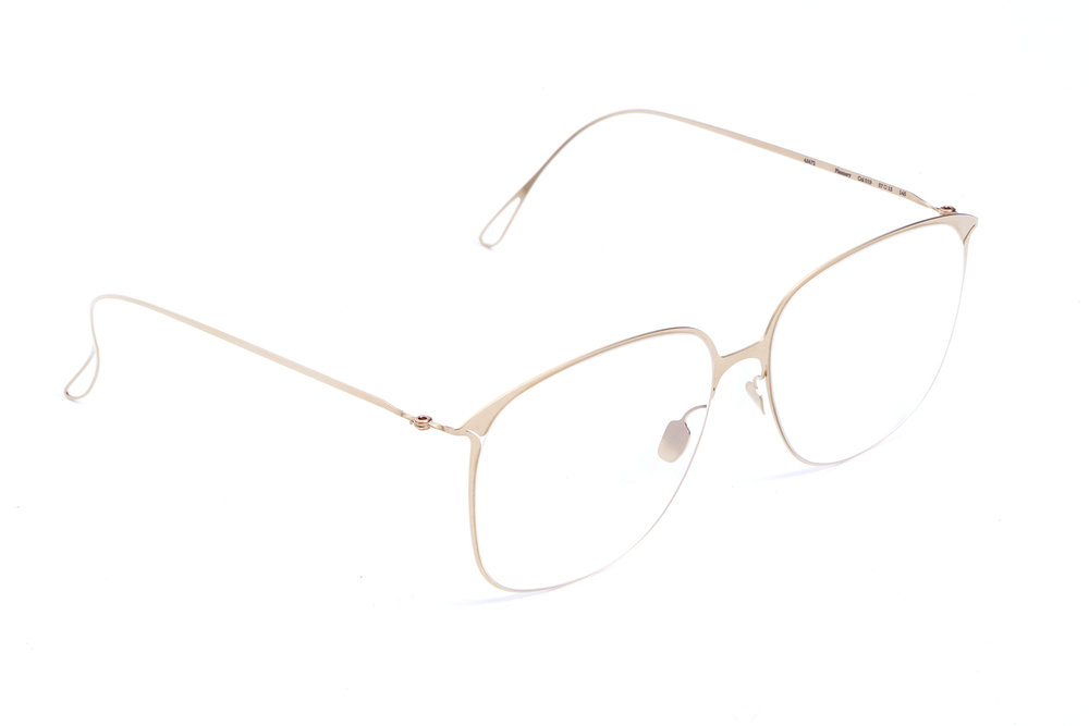 haffmans_neumeister_flannery_crémant_clear_ultralight_eyeglasses_angle_102403.jpg